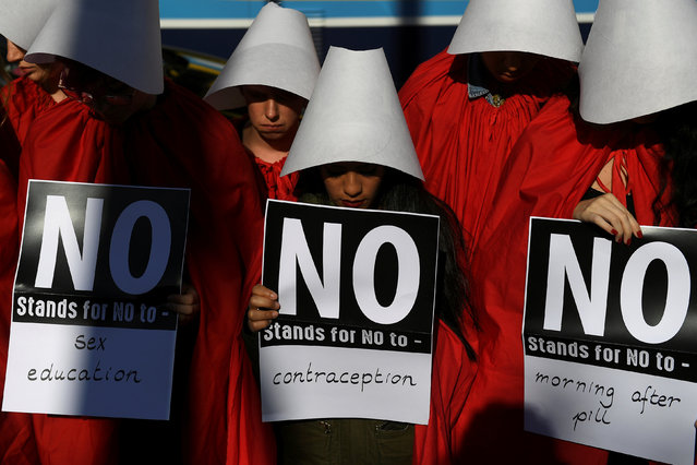 Pro-Choice activists dress up as characters from the Handmaid's Tale in a City centre demonstration ahead of a May 25 referendum on abortion law, in Dublin, Ireland May 23, 2018. (Photo by Clodagh Kilcoyne/Reuters)
