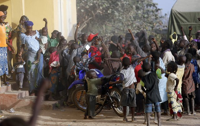 Children displaced as a result of Boko Haram attacks in the northeast region of Nigeria, cheer at a camp for internally displaced persons (IDP) in Yola, Adamawa State January 13, 2015. (Photo by Afolabi Sotunde/Reuters)