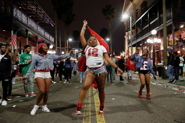 People gather in Ybor city after the Tampa Bay Buccaneers Super Bowl LV win over the Kansas City Chiefs, in Tampa, Florida, U.S., February 8, 2021. (Photo by Shannon Stapleton/Reuters)