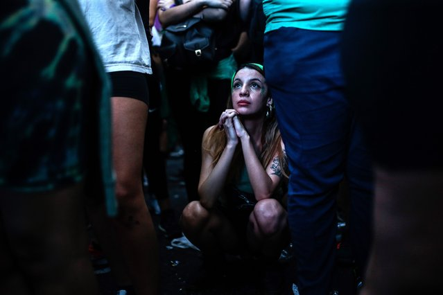 Women await the approval of the new abortion law as they hold a vigil in front of the Congress, in Buenos Aires, Argentina, 11 December 2020. The new abortion bill would allow to get an abortion until the 14th week of pregnancy. (Photo by Juan Ignacio Roncoroni/EPA/EFE)