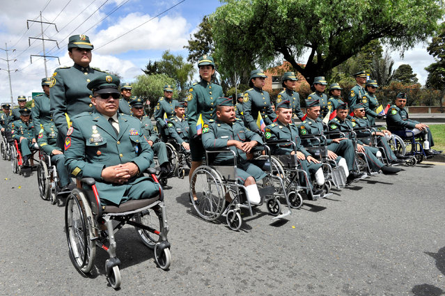 Colombian amputee soldiers take part in a military parade to commemorate Colombia's 208th independence anniversary in Bogota, Colombia July 20, 2018. (Photo by Carlos Julio Martinez/Reuters)