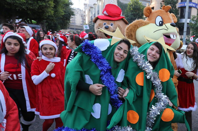 Students dressed in the festive Christmas costumes ride take part in a Christmas parade in Beirut, Lebanon, December 22, 2015. (Photo by Aziz Taher/Reuters)