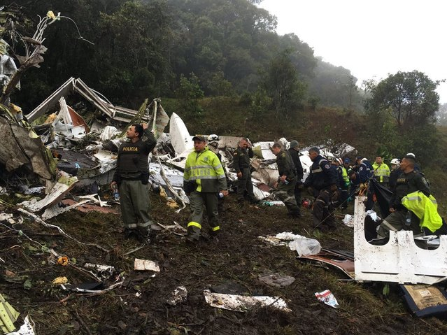 Images posted by the Antioquia Police Department show the scene where a chartered flight crashed. Seventy-six people are confirmed dead following a plane crash outside Medellin, Colombiaon November 29, 2016. (Photo by AP Photo/Antioquia Police Department)