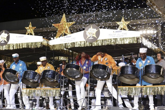 "Confetti falls as members of the Massy Trinidad All Stars steelband play ""Unquestionable"" to win the large band category during the National Panorama finals held by the governing body Pan Trinbago at the Queen's Park Savannah in Port-of-Spain February 15, 2015. (Photo by Andrea De Silva/Reuters)"