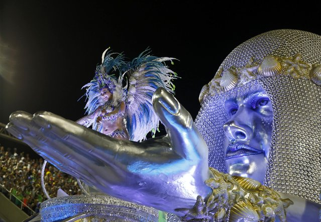 A reveler from the Portela samba school participates in the annual carnival parade in Rio de Janeiro's Sambadrome, February 16, 2015. (Photo by Pilar Olivares/Reuters)