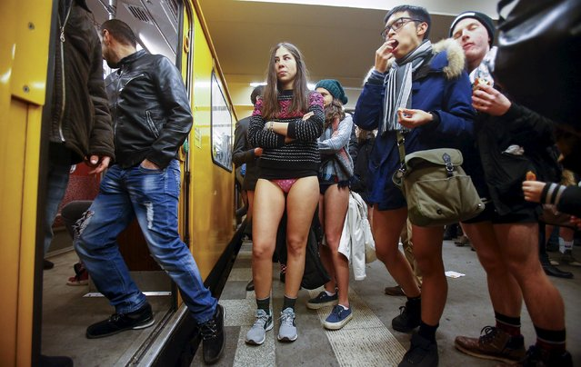 People take part in the 'No Pants Subway Ride' in Berlin, January 10, 2016. (Photo by Hannibal Hanschke/Reuters)