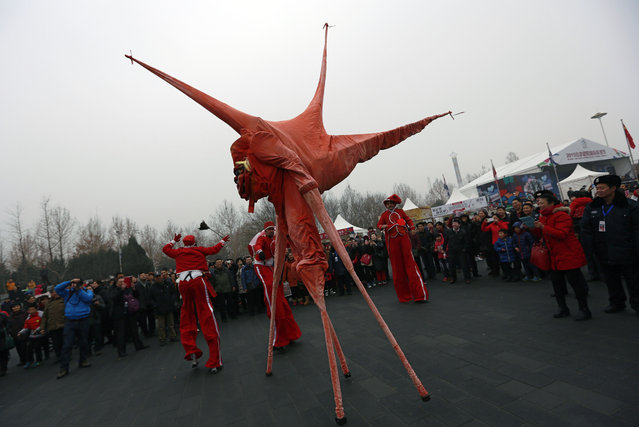 Performers from the Vladimir circus theater entertain the crowds during the Chaoyang Park's International Spring Carnival for the Lunar New Year celebration in Beijing Saturday, February 21, 2015. (Photo by Andy Wong/AP Photo)