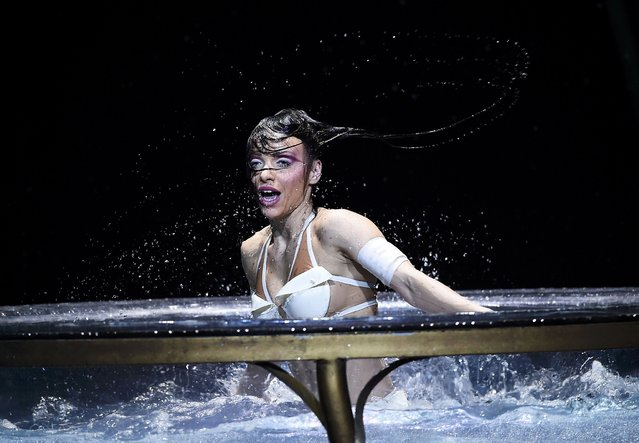 An artist performs in water during a dress rehearsal for 'Amaluna', a show by Cirque du Soleil, at the Royal Albert Hall in London, Britain January 15, 2016. (Photo by Dylan Martinez/Reuters)