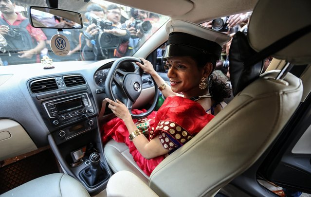 Indian transgender driver Sanjeevani Chavan poses for photographs inside the Wings travels taxi, in Mumbai, India, 20 January 2016. According to reports, Wings Travels Management announced the launch of India's first ever Radio Cab Services powered by the LGBT (Lesbian, Gay, Bisexual and Transgender) community, a unique enpowerment intiative in association with the Humsafar Trust. (Photo by Divyakant Solanki/EPA)