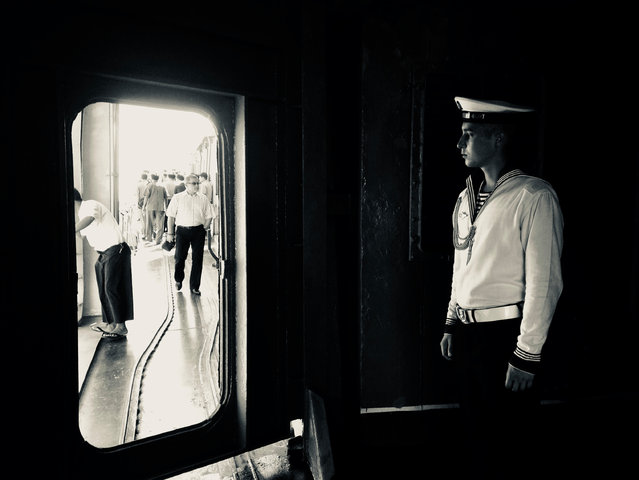 """""""This image was taken on board a Russian naval destroyer when it docked temporarily in Yangon, Myanmar. We managed to join a party of people being given a tour of the ship"""". (Photo by Katherine East/The Guardian)"""