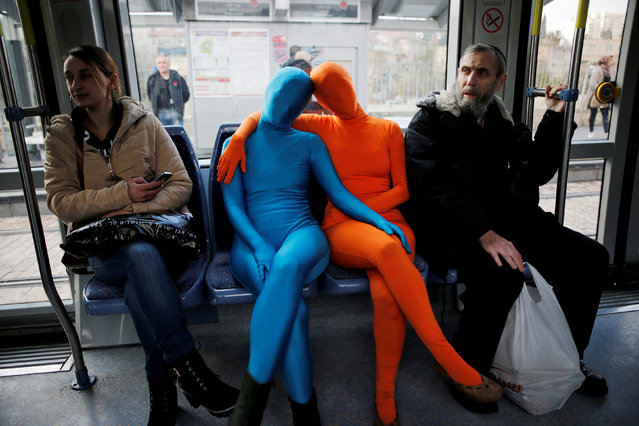 Members of the Prizma Ensemble wearing full solid-coloured bodysuits take part in a festival for the Jewish holiday of Hanukkah, in Jerusalem December 26, 2016. (Photo by Amir Cohen/Reuters)