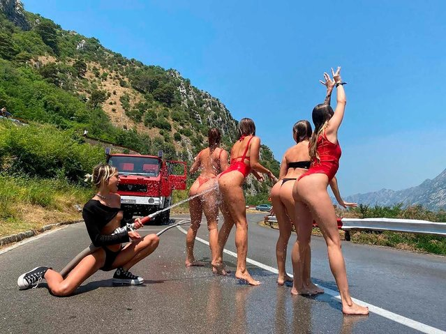 """Three members of the notorious """"Ukrainian Butt Squad"""" were arrested in Montenegro in July 2021 after """"shamelessly"""" undressing and spraying each other with a firehouse on a public road. It is the latest legal scandal to grip the group of women, who were previously jailed for a racy balcony shoot on a skyscraper in Dubai. (Photo from social networks)"""