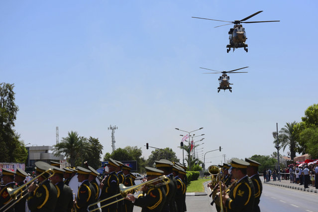 Turkish military helicopters take part in the military parade marking the 47th anniversary of the 1974 Turkish invasion in the Turkish occupied area of the divided capital Nicosia, Cyprus, Tuesday, July 20, 2021. (Photo by Nedim Enginsoy/AP Photo)