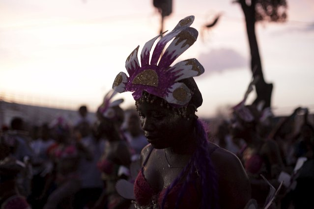 A reveller takes part in the Carnival 2016 parade in Port-au-Prince, Haiti, February 9, 2016. Carnival celebrations on Sunday were canceled due to the eruption of violent anti-government protests. (Photo by Andres Martinez Casares/Reuters)