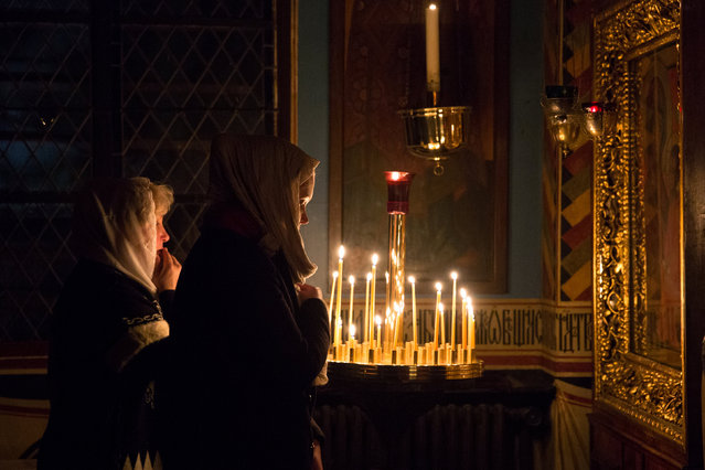Women pray during the Vigil mass at the Russian Orthodox church Saint Serge in Paris, January 6, 2017 on the eve of Orthodox Christmas Day, which is celebrated on January 7. (Photo by Philippe Wojazer/Reuters)