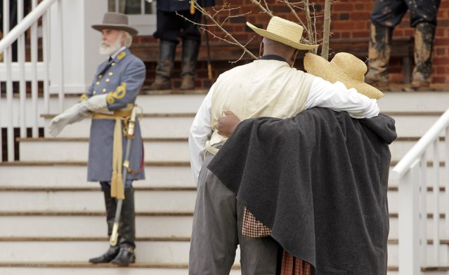 A period-costumed actor of General Robert E. Lee leaves after the surrender during the 150th anniversary re-enactment of the surrender of General Robert E. Lee to General Ulysses S. Grant at the Museum of Confederacy in Appomattox, Virginia,  April 9, 2015. (Photo by Jay Paul/Reuters)