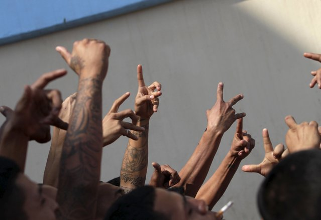 Inmates gesture gang signs in the Topo Chico prison, during a media tour, in Monterrey, Mexico, February 17, 2016. (Photo by Daniel Becerril/Reuters)