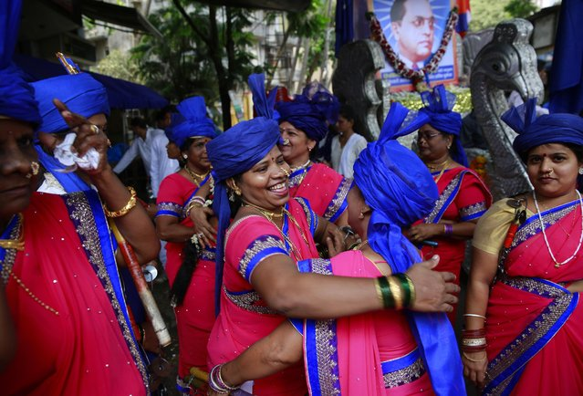 Indian women greet each other as they arrive to participate in a procession to mark the birth anniversary of Bhim Rao Ambedkar in Mumbai, India, Tuesday, April 14, 2015. (Photo by Rafiq Maqbool/AP Photo)