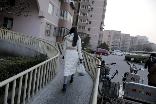 Online hostess Xianggong walks back to her apartment in Beijing, February 10, 2015. (Photo by Jason Lee/Reuters)