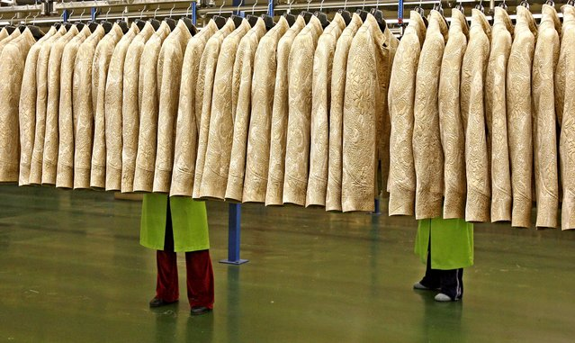 Workers work at the Zara factory at the headquarters of Inditex group in Arteixo, Northern Spain in this 29 March 2006 file photo. Spain is expected to release GDP data this week. (Photo by Miguel Vidal/Reuters)