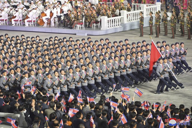 In this photo provided by the North Korean government, North Korean troops parade during a celebration of the nation's 73rd anniversary that was overseen by leader Kim Jong Un, at Kim Il Sung Square in Pyongyang, North Korea, early Thursday, September 9, 2021. (Photo by KCNA via KNS/AFP Photo/Stringer)