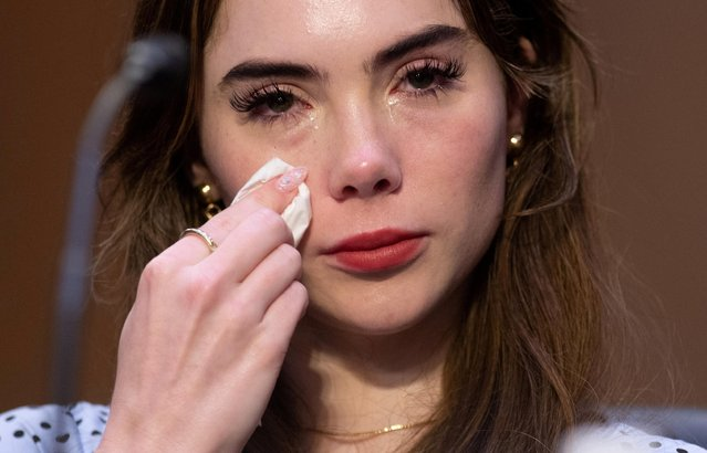 """U.S. Olympic gymnast McKayla Maroney testifies during a Senate Judiciary hearing in Washington, September 15, 2021. Maroney told lawmakers she feels betrayed by FBI agents, after they failed to investigate former USA Gymnastics doctor Larry Nassar, despite her telling them he had sexually abused her. Maroney recalled how in 2015 she spent three hours on the phone telling the FBI the details of her story that her own mother had not even heard, including accounts of sexual abuse she endured during the Olympic games in London by Nassar, whom she described as """"more of a pedophile"""" than he was a doctor. (Photo by Saul Loeb/Pool via Reuters)"""