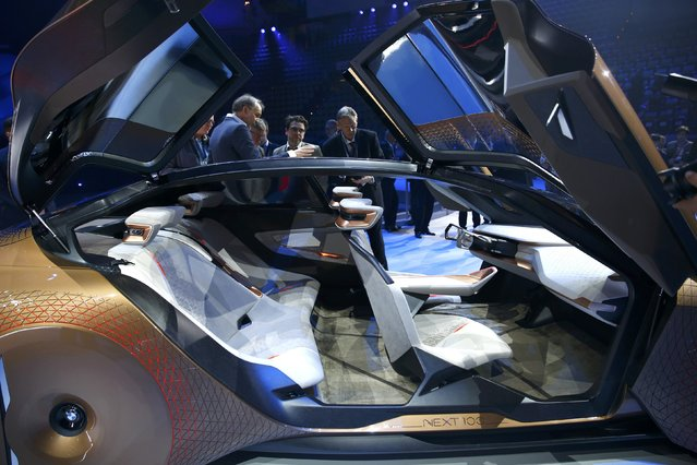 """People look at the interior of the BMW """"Vision Next 100"""" concept car during centenary celebrations at the Olympic Hall in Munich, southern Germany March 7, 2016. (Photo by Michael Dalder/Reuters)"""