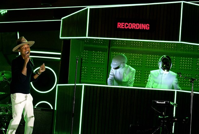 "Pharrell Williams, with Thomas Bangalter and Guy-Manuel de Homem-Christo of Daft Punk, performs during the Grammy Awards. The French electronic duo's ""Random Access Memories"" won album of the year and their infectious hit, ""Get Lucky"", won record of the year at the awards show. The song features Pharrell Williams and Nile Rodgers. (Photo by Kevork Djansezian/Getty Images)"