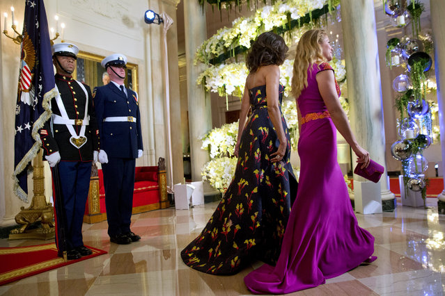 First lady Michelle Obama and Sophie Grégoire Trudeau walk through the White House as they follow their husbands President Barack Obama and Canadian Prime Minister Justin Trudeau to the State Dinner in Washington, Thursday, March 10, 2016. (Photo by Jacquelyn Martin/AP Photo)
