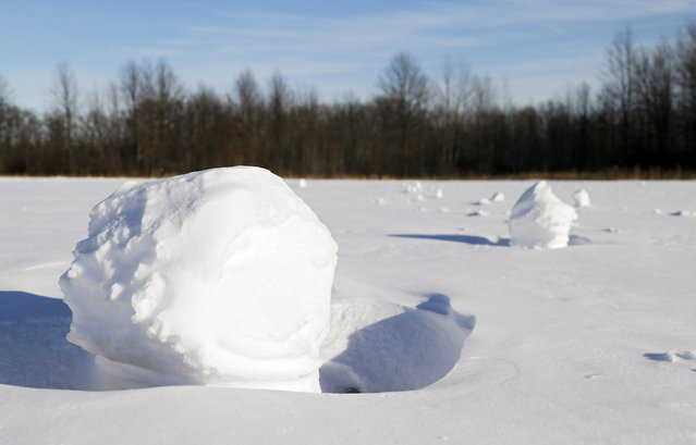 Snow balls lie in a field Tuesday, January 28, 2014, in Olmsted Township, Ohio. (Photo by Mark Duncan/AP Photo)