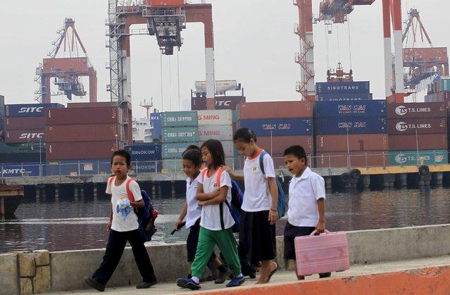 School children walk past the Manila South Harbor, metro Manila in this February 15, 2016 file photo. (Photo by Romeo Ranoco/Reuters)