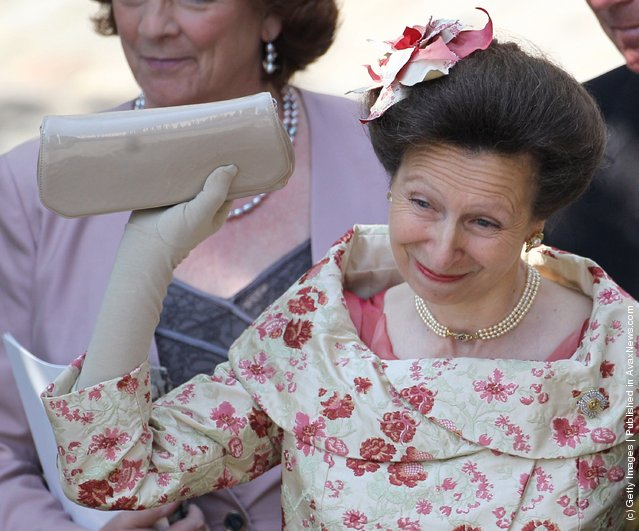 Princess Anne, Princess Royal waves off Zara Philips as she eaves Canongate Kirk on the afternoon of her wedding to Mike Tindall on July 30, 2011 in Edinburgh, Scotland