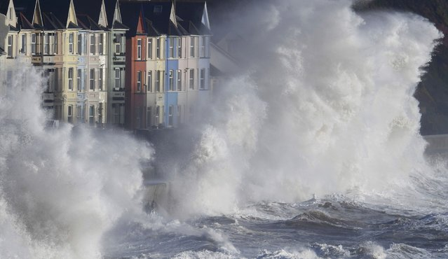 Waves hit the seawall during heavy seas and high winds in Dawlish in south west Britain, February 2, 2017. (Photo by Toby Melville/Reuters)