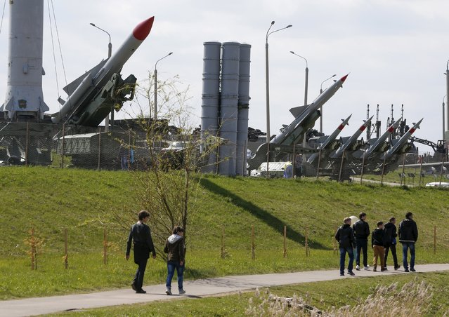 """People visit the """"Stalin Line"""" memorial, where collected samples of military equipment from the time of the World War Two to the present day are displayed, near the village of Goroshki, west of Minsk, May 5, 2015. (Photo by Vasily Fedosenko/Reuters)"""