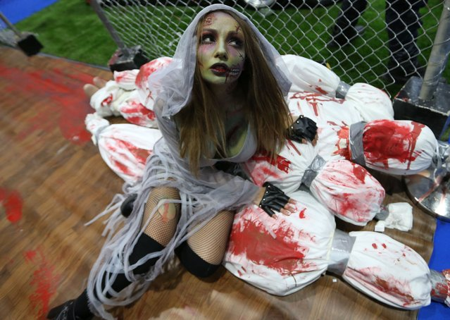 A guest dressed as a zombie attends the Middle East Film & Comic Con (MEFCC) in Gulf emirate of Dubai, United Arab Emirates, 11 April 2019. The event runs until 13 April 2019. (Photo by Ali Haider/EPA/EFE)