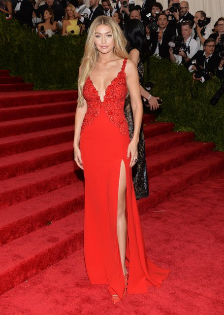 """Gigi Hadid arrives at The Metropolitan Museum of Art's Costume Institute benefit gala celebrating """"China: Through the Looking Glass"""" on Monday, May 4, 2015, in New York. (Photo by Evan Agostini/Invision/AP Photo)"""