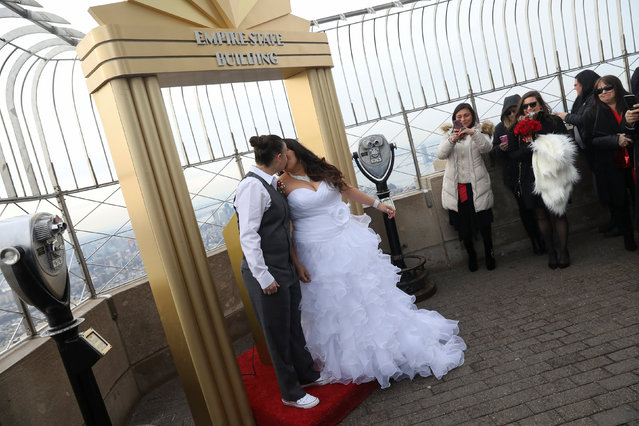 Krista Owens (L) and Danielle Reno kiss after exchanging their vows at their Valentine's Day wedding ceremony on top of the Empire State Building in New York U.S., February 14, 2017. (Photo by Shannon Stapleton/Reuters)