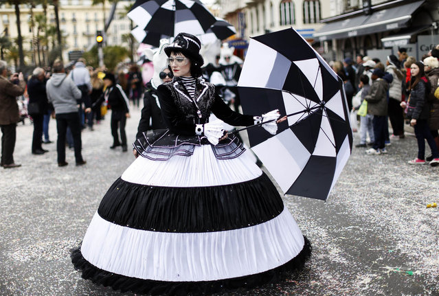 """Dancers parade on February 25, 2014 during the Nice Carnival, southeastern France. The theme of this year's carnival, running from February 14 until March 4, 2014, is the """"King of Gastronomy"""". (Photo by Valery Hache/AFP Photo)"""