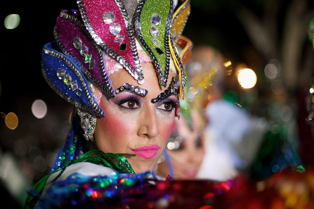 A member of 'Los Joroperos' performs in the troupes dancing contest during the Santa Cruz de Tenerife Carnival on March 1, 2014 in Santa Cruz de Tenerife on the Canary island of Tenerife, Spain. (Photo by Pablo Blazquez Dominguez/Getty Images)