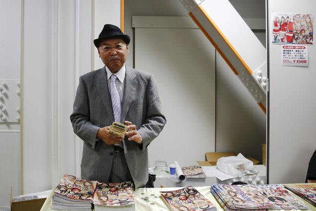 """The President of the Stardom female professional wrestling promotion Hiroshi """"Rossy"""" Ogawa sells brochures before the start of a wrestling show at Korakuen Hall in Tokyo, Japan, December 23, 2015. (Photo by Thomas Peter/Reuters)"""