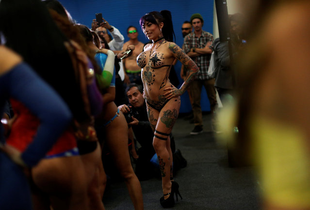 "An exotic model poses for photographs at a news conference to promote the ""Expo s*x and Eroticism"" adult exhibition in Mexico City, Mexico March 1, 2017. (Photo by Carlos Jasso/Reuters)"