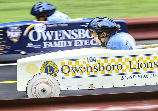 Simon Hamilton, 8, foreground, of Philpot, Ky, competes with Zack Gordon of Owensboro, Ky, as they make their way down the Ben Hawes Park Gravity Racing Track during the Owensboro Lions Club Soap Box Derby, Saturday, June 8, 2019, in Owensboro, Ky. (Photo by Greg Eans/The Messenger-Inquirer via AP Photo)