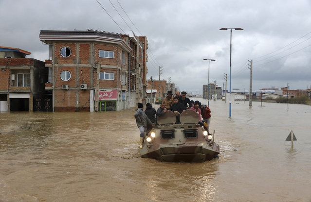 Military vehicles rescue people after flash flooding around the northern city of Aq Qala in Golestan province, Iran, Monday, March 25, 2019. Iranian state TV reported on Monday that flash floods in southern Iran have killed at least 17 people and injured scores more. The northern provinces of Golestan and Mazandaran have been struggling with flooding for over a week, and five people have been killed, according to the state-run Press TV channel. (Photo by Mohsen Esmaeilzadeh/AP Photo/ISNA)