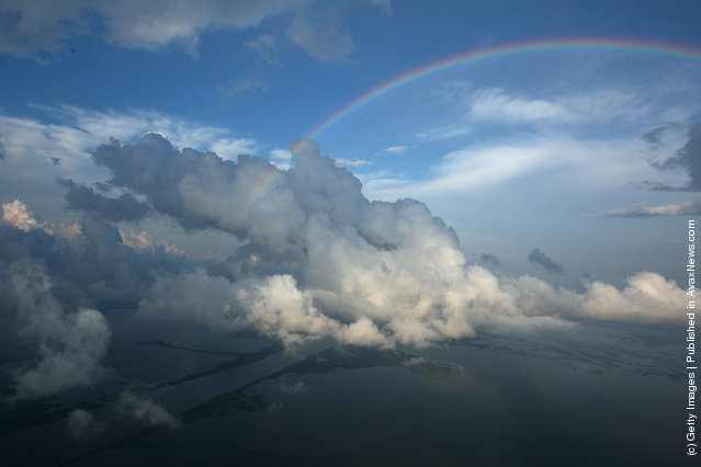 A rainbow appears over the Louisiana gulf May 26, 2010 in the Gulf of Mexico near Brush Island, Louisiana