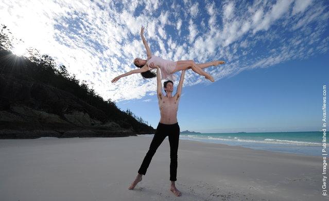 Australian ballet dancers rehearse their moves on Whitehaven Beach on Hamilton Island, Australia
