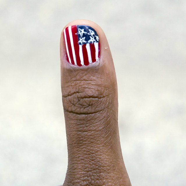 A pattern in the design of the U.S. flag is seen on a girl's fingernail in Manhattan, New York, July 3, 2015, ahead of the Fourth of July holiday. (Photo by Andrew Kelly/Reuters)