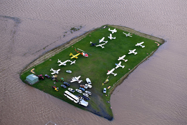 Aircraft can be seen surrounded by floodwaters near the airport of the northern New South Wales town of Lismore, Australia, March 31, 2017 after heavy rains associated with Cyclone Debbie swelled rivers to record heights across the region. (Photo by Dave Hunt/Reuters/AAP)