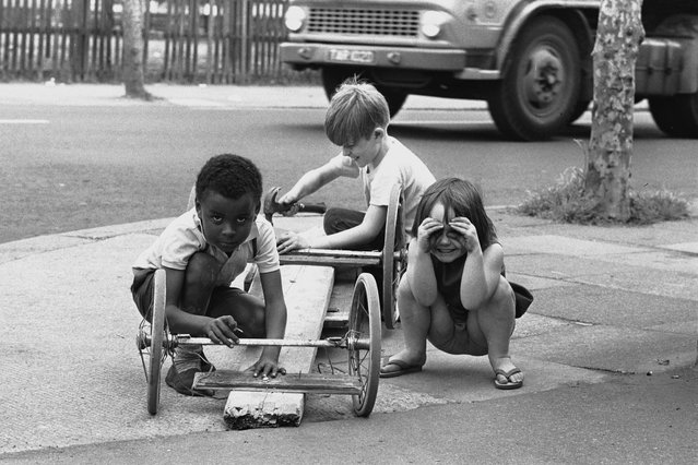 Three children build themselves a go-cart in the East End of London, 1960s. (Photo by Steve Lewis/Getty Images)