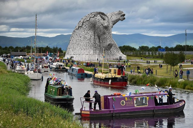 The Kelpies sculptures are officially opened by Princess Anne, Princess Royal and a flotilla of boats on July 8, 2015 in Falkirk, Scotland. Sculptor Andy Scott also attended  the opening, along with Duke, a Clydesdale horse which was one of the models for the 30m works, which have received more than one million visitors since they were completed in April 2014. (Photo by Jeff J Mitchell/Getty Images)