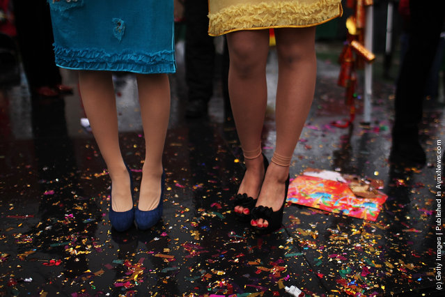 Two Chinese singers stand on glitter during celebrations of the Chinese New Year  in Chinatown